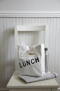 Lunch Bag (via design for minikind)... I am going to try to DIY make this With a white bag and black fabric pin.