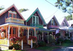 I absolutely love this row of colorful cottages!