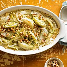 Baked Fennel with Parmesan - Crisp fennel is the flavorful foundation for this savory Parmesan- and walnut-topped casserole side. And at just 137 calories per serving, you can enjoy every guilt-free bite.