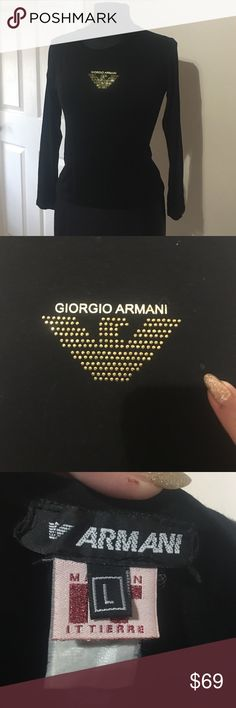 Giorgio Armani long sleeve tee Black rayon and spandex with Giorgio Armani logo in gold (words printed,symbol studded) on center of chest. Scoop neckline. Size L (fits like a M. Does have a vary small pick as seen in 2nd pic. Giorgio Armani Tops Tees - Long Sleeve