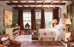 So exotic....look at those ikat walls...Suzani bedding...Persian carpet...possibly Balinese chair...and the Chinese style scrolled table at foot of bed....plus the fabulously designed beams.  Not much NOT to like.  Pretty fabulous
