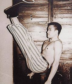 Young Bruce doing a V-sit which requires intense abdominal strength. Legs are usually at chest level.