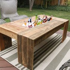 http://www.remodelaholic.com/rustic-pallet-wood-coffee-table-drink-cooler/