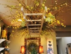 Savvy Seasons by Liz: Blooming Hanging Ladder-- I would like this on patio with glass jars hanging filled with flowers & candles and string lights