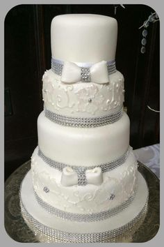 4 tier bling and bows wedding cake
