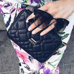 Silvia Postolatiev of @postolatieva carries her #LoveGUESS