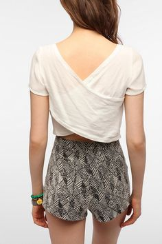 I like this. Just simple and breezy. Air flow is important in this heat.  Lucca Couture Cross-Back Tee from UrbanOutfitters