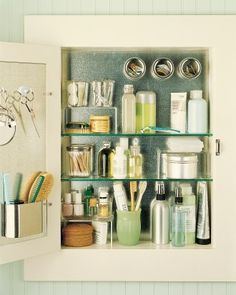 Affix a sheet of precut galvanized steel to the interior of your medicine cabinet with construction adhesive. Magnetic hooks can hold scissors and a mirror, and small plastic cups with magnetic bottoms corral small necessities, such as rubber bands and hair clips.
