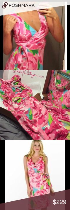 Lilly Pulitzer First impressions wrap dress Rare This dress is gorgeous EEEUC size large ,can wear ruffles tucked in or out  offered less on other platforms Lilly Pulitzer Dresses Midi