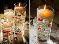glass vase with candles and rose