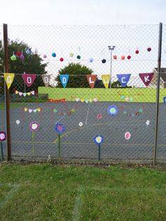 Large and Small bunting, flowers and pompoms on our yarn bomb