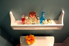What a good idea for perfume storage. Except I'd want it in the bedroom, not the bathroom.