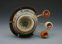 Annie Pennington.  Brooch. Polymer clay, colored pencil, sterling silver, copper and wool.