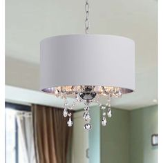 Add this shaded pendant chandelier to a living or dining room for a touch of elegance. It provides a soft light to your dining room table with three 60-watt bulbs. The chrome and white finish makes the fixture look great with any color scheme.