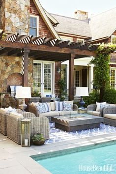 Libby Langdon let us in on four indoor decorating moves to take outdoors this year. She refers to this outdoor patio, encouraging the use of comfy outdoor cushions and throw pillows that are endlessly inviting.