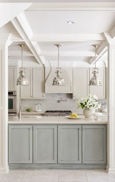 love the duck egg blue cupboards and industrial lights
