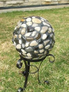 OLD BOWLING BALL and hot glued river rock garden/walkway accents!