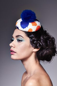 Jane | Label: Lisa Tan Millinery | Spring/Summer 2014 | Small beret covered in ink splat silk, topped with a marabou pom-pom