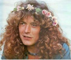 Robert Plant with flowers in his hair!!! So cute!!