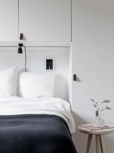 Fresh home with smart bedroom storage - via Coco Lapine Design blog