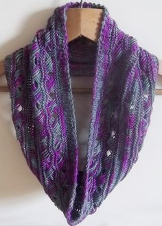 Free Knitting Pattern for Cottage Garden Cowl - This infinity scarf cowl combines Indian Cross Stitch with a 3x2 rib and the added textural detail of a Vikkel braid. Designed by Kezia Cole. Great with multicolor yarn!