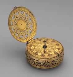 Clock watch, ca. 1600-1610  Movement by Michael Nouen, or Nouwen (Flemish, active London, ca. 1600–1610)  Case: gilded brass; Dial: gilded brass, with a blued steel hand; Movement: gilded brass and iron