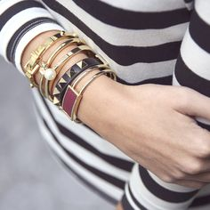 Amp up classic stripes with an arm party with some edge.