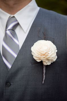 boutonniere - a single balsa wood flower, accented with angel vine.   The stem was finished in pewter satin ribbon.