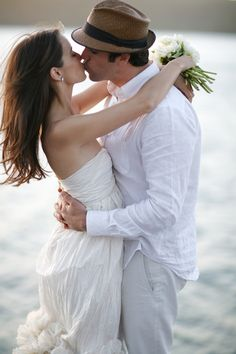 lakeside-wedding-bride-groom-kiss-natural-fedora