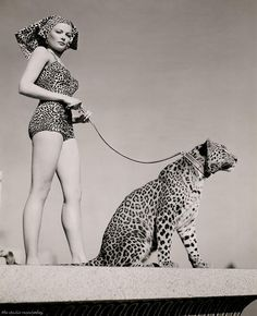 Gene Tierney, going for a walk with her funny-looking but well-accessorized dog.