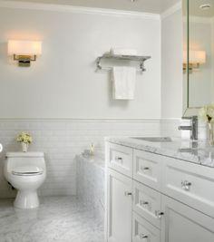 Marble bathroom floor, white vanity, white subway tiles (subway tiles for the shower area only)