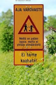Translation:  DRIVE CAREFULLY! We have a lot of children but no extra. No need to speeding!""