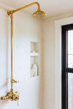 Lovely walk in shower is clad in stucco lined with a gold vintage exposed plumbing shower kit. Small Bathroom With Shower, Walk In Shower, Master Shower, Small Bathrooms, Shower Kits, Bathroom Styling, Bathroom Inspo, Paris Bathroom, 1950s Bathroom