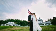 Bride and Groom Kiss in front of Trump Grand Hall at Trump Winery