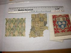 Textiles in the Study Collection. Museum nos (left to right) 859-1899; 8666-1863; 847-1899 | 2 different greens and blues, golden toned silk ? linen embroidery bottom part, different pattern