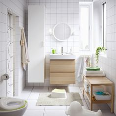 Incredible Bathroom Design Ideas With Tall Pure White Finish Storage Cabinet And Floating Unfinished Oak Wood Vanity Cabinet Sink Under Cool Round Framed Wall Mirror, Fascinating Storage Cabinets For Small Bathroom Design: Bathroom, Furniture