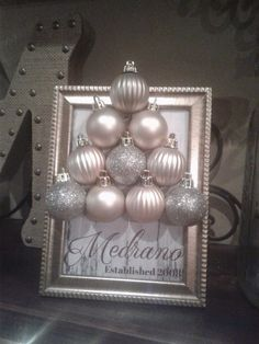Personalized Christmas Frame. Grab some cheap Dollar Store ornaments and copy this gorgeous wall idea!