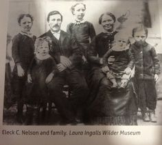 Eleck and Olena Nelson, Norwegian immigrants, and five of their six children in the early 1880s. The Nelsons were the Ingalls' closest neighbors On The Banks of Plum Creek and were invaluable in helping the Ingalls get through the tough times. When the Ingalls family moved near the Nelsons in 1874, Eleck and Olena were 28 years old and had only two very young daughters. Anna, who was 2 at the time, is the one to whom Laura was forced to give her doll, which she later found in a mud puddle.