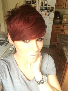 Sleek red pixie with longer bangs