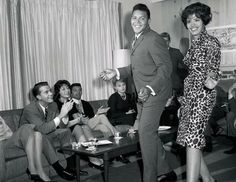 Dick Clark is on the couch while Chubby Checker and a woman do The Twist.  Via Blackenterprise.com