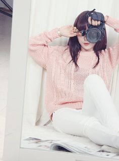 Pale pink over sized sweater over white skinnies