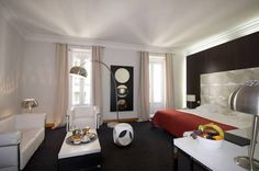 Suite Prado Madrid This hotel enjoys a very central location in the city, next to the Teatro Español and Madrid's golden triangle of art: the Prado, Thyssen and Reina Sofia museums. Puerta del Sol is just 5 minutes' walk away.