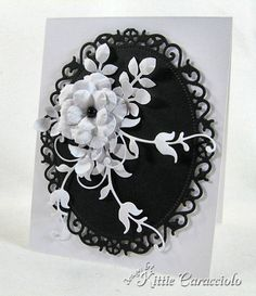 Black and White Posies  Accessories: My Favorite Things Pretty Posies and Leafy Flourish, Punch Bunch Ash Leaf, Spellbinders Floral Oval, Glossy Accents, Stylus, Mat, Pearl, Mounting Tape.