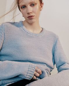 """Windswept and interesting"" editorial by @mattlainphoto  featuring my Alder textured block stripe jumper in blue.  Voluminous yet lightweight yarn created by encasing bright blue polyamide fibre with a knitted chainette tube of white cotton  Available to shop via the bio link with free international delivery 🔝"
