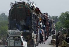 People fleeing the military offensive against the Pakistani militants in North Waziristan, travel atop a vehicle with their belongings while entering Bannu, located in Pakistan's Khyber-Pakhtunkhwa province, June 20, 2014. REUTERS/Ihsan Khattak