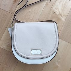 HP Kate Spade Lilly Oliver St Saddle Bag So trendy and super soft leather!! Blush and cream 2-tone. Gold hardware. Crossbody. Secret front compartment. 8.5 x 8 x 3 inches. This one is a beauty!  No trades. kate spade Bags Crossbody Bags