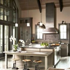 Kitchen Island and Table with High Ceiling and Natural Light