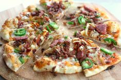 Bacon Jalapeño Sausage Pizza With Sriracha Sauce. Yum!