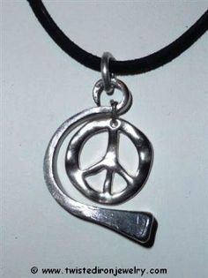 Horseshoe Nail Arch with Peace Sign welded and coated with clearcoat to prevent rust.