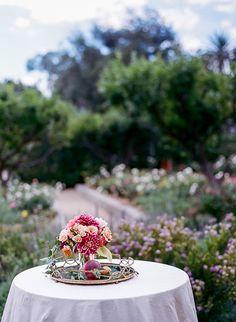 Dahlia, rose, and fresh peach arrangements for cocktail hour | Brides.com
